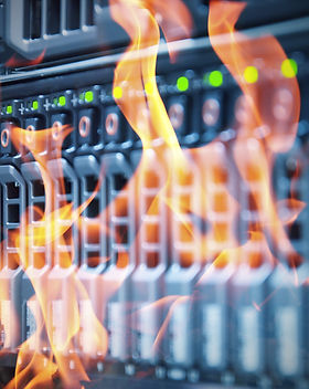 A fire burning a server to exemplify the need for backup and disaster recovery services