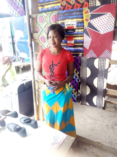 Irene sells chitenge material and shoes for a living. Chitenges are long pieces of fabric (similar to a sarong), that are worn by Zambian women.