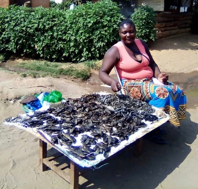 Esther sells fish to make a living.