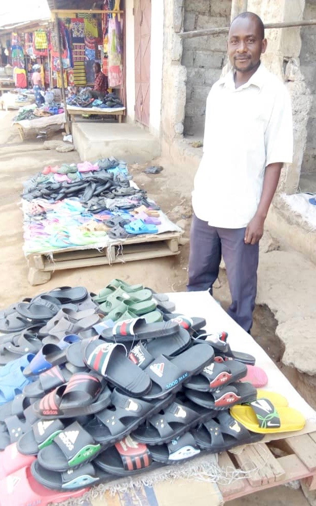 Bornface sells slippers at the marketplace for a living.