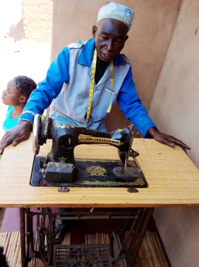 Forgah is a tailor and sews clothes for a living