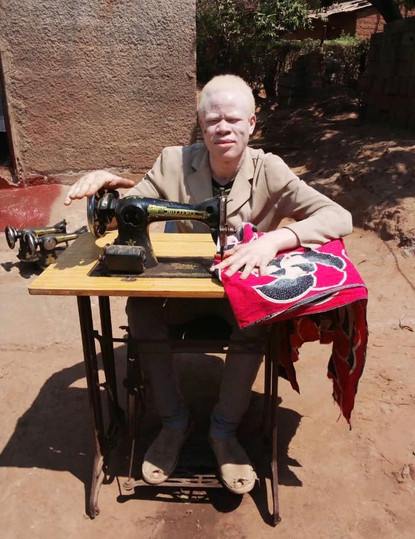 Joseph is a tailor and sews school uniforms and other clothing items for a living.