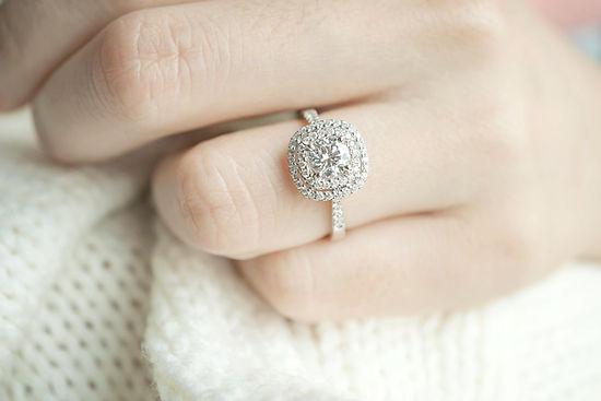 A jeweller appraises a diamond