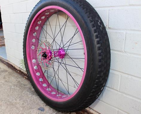 Candy pink powder coated bike rim
