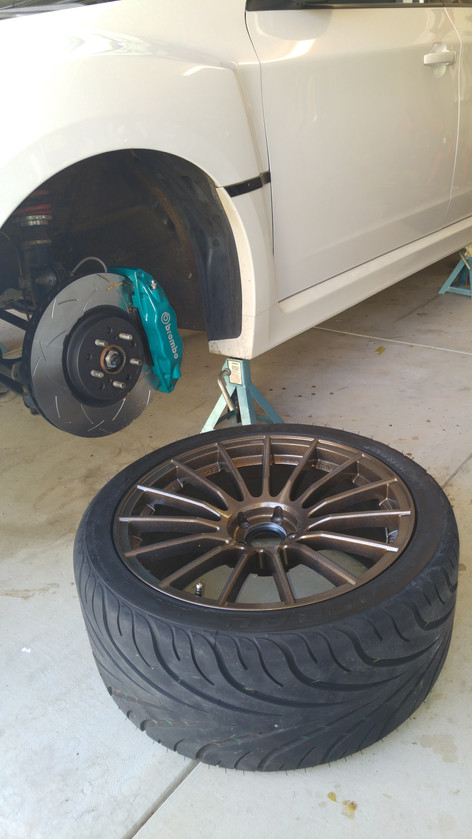Teal powder coated brakes and bronze powder coated rims