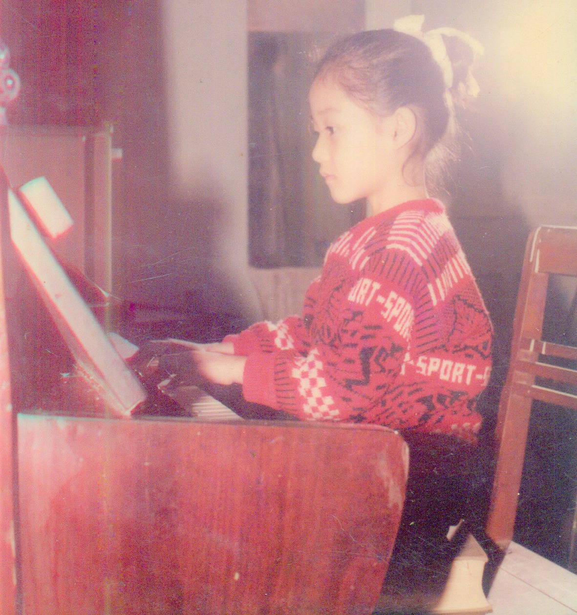 First photo playing piano at 4 years old