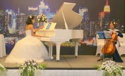 Wedding performance with her cellist Mom  At Intercontinental Hanoi Hotel