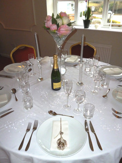 Wedding table with rose.JPG