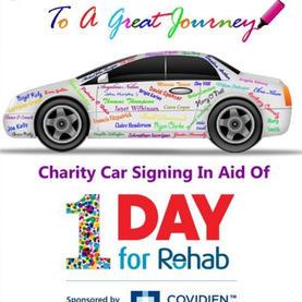 rehab-car-signing.jpg