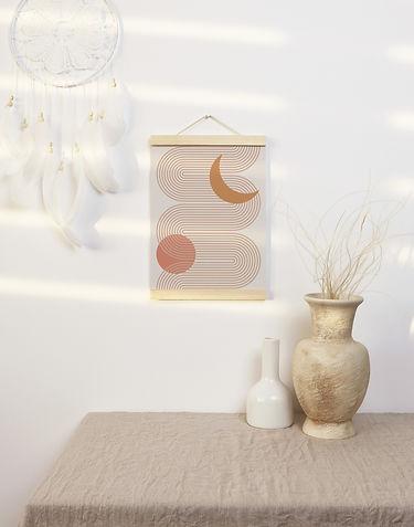 bohemian moon art print hanging on a wall