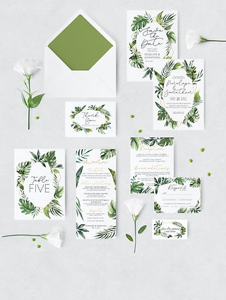 tropical wedding suite with envelope and flowers