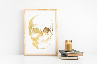 gold foil human skull in wood picture frame