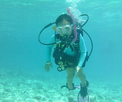 Chloe Mei scuba diving at the age of 10.