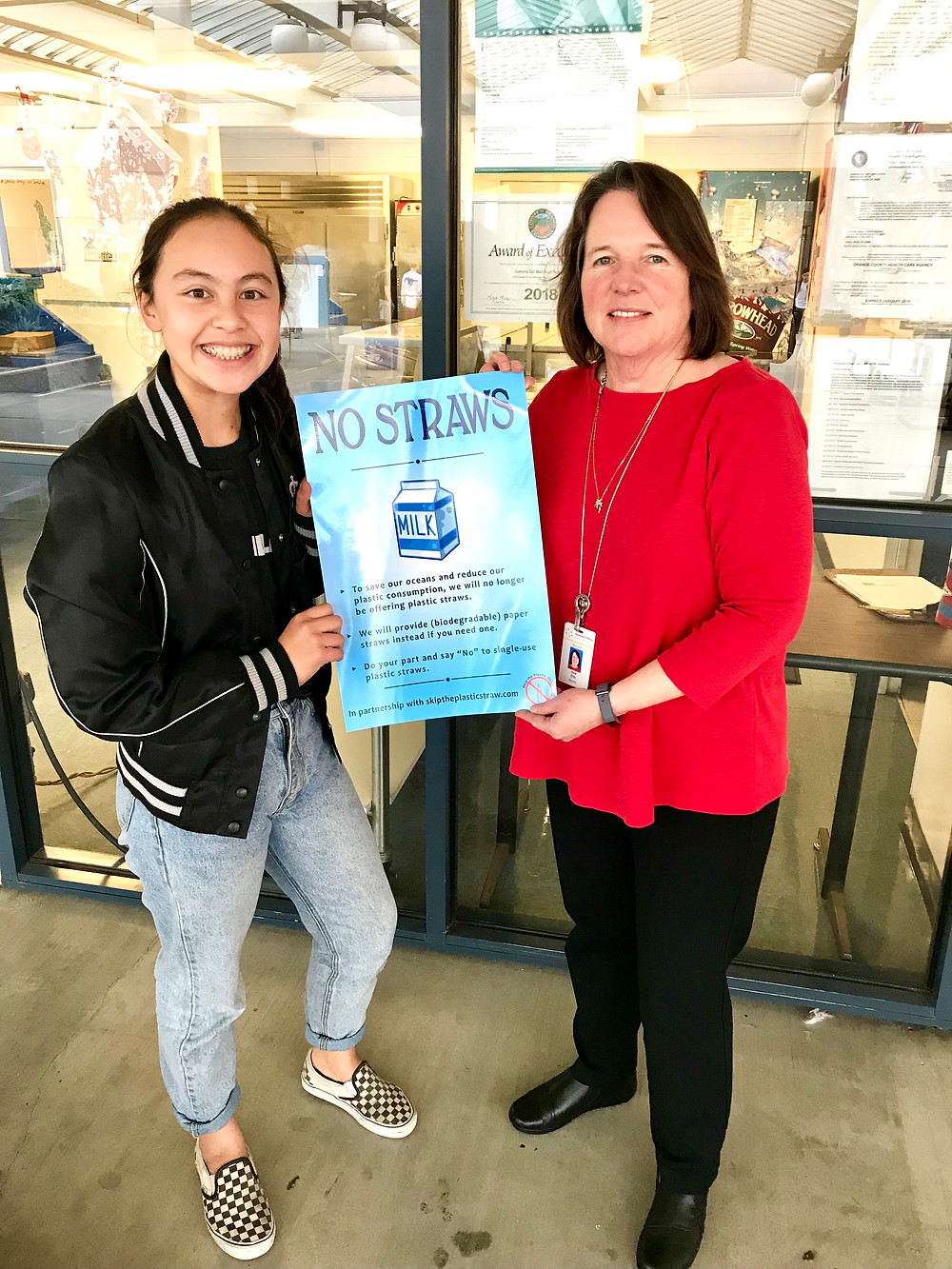 Mrs. Dale Ellis, Nutrition Director of Newport-Mesa Unified School District, and me holding Skip the Plastic Straw Poster.