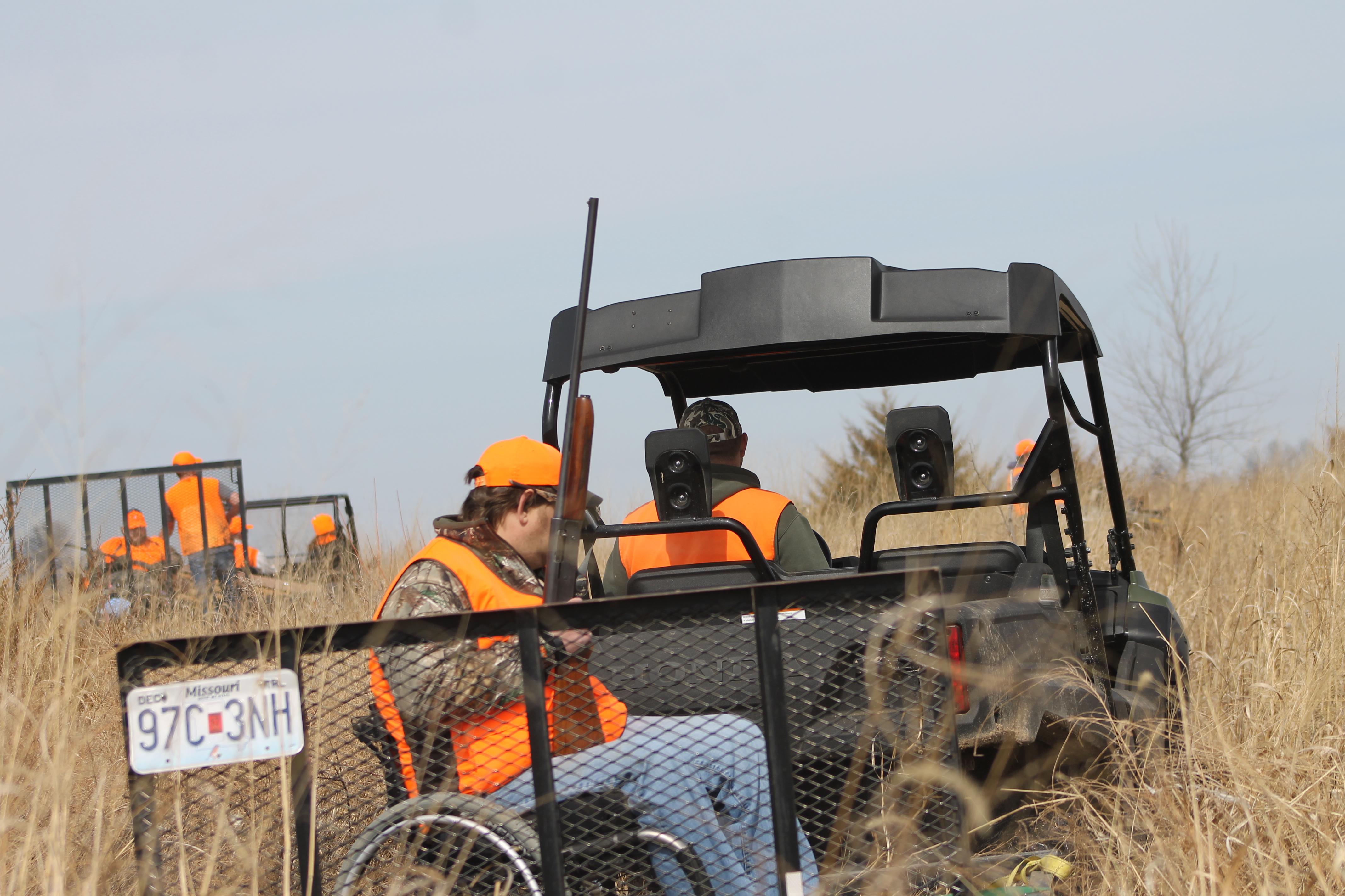 Hunter riding on trailer