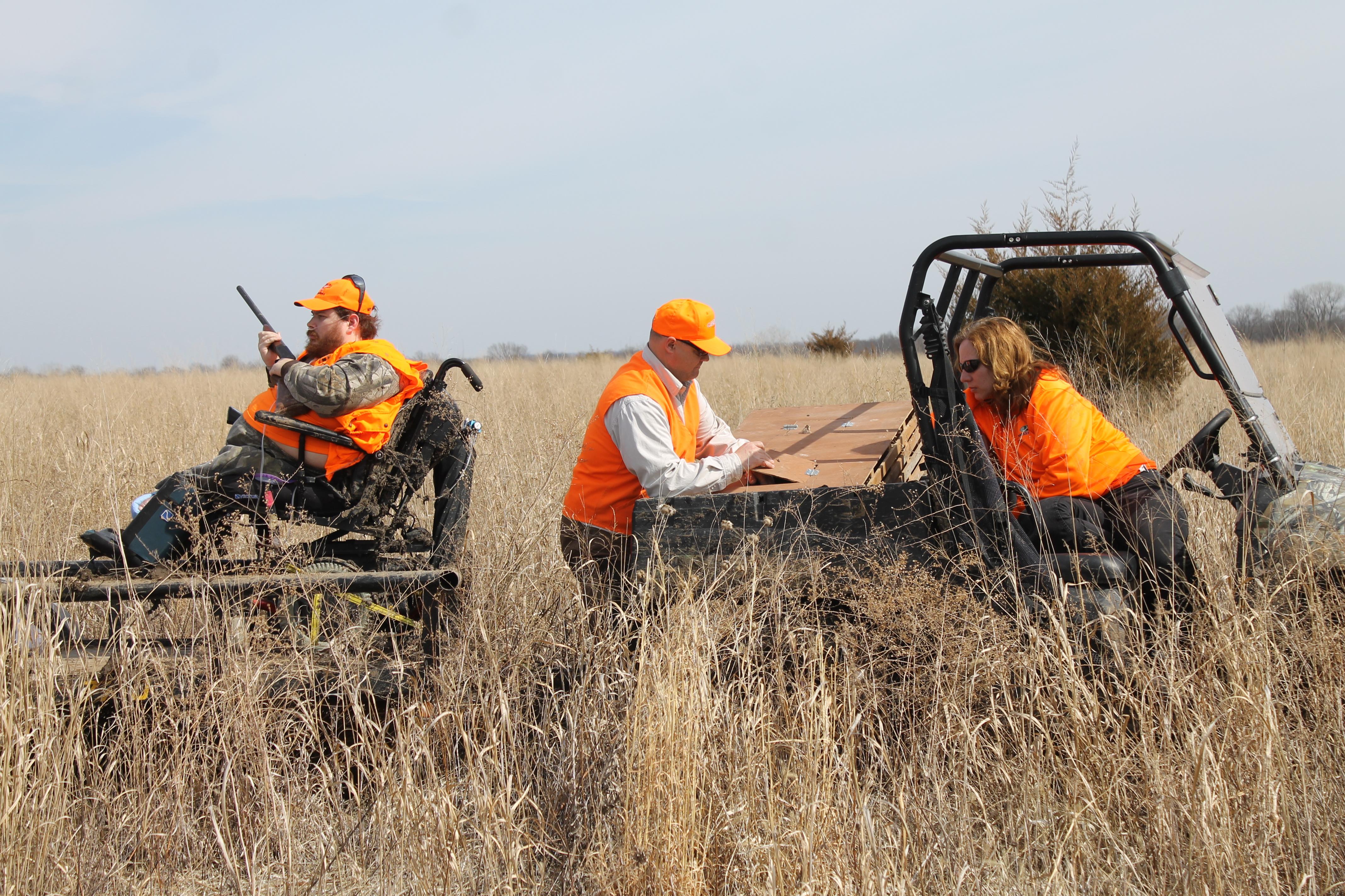 Hunters around cart