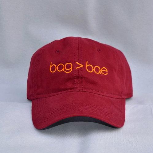 bag > bae hat - maroon & orange