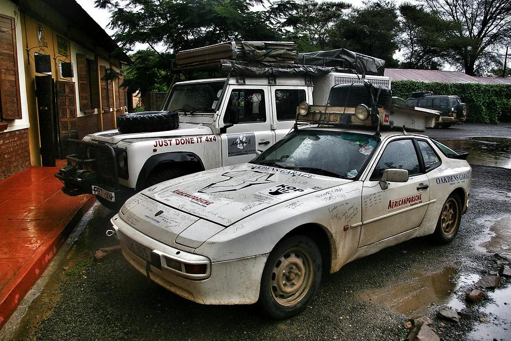 Overlanding Porsche 944 and Land Rover Defender in Zambia.