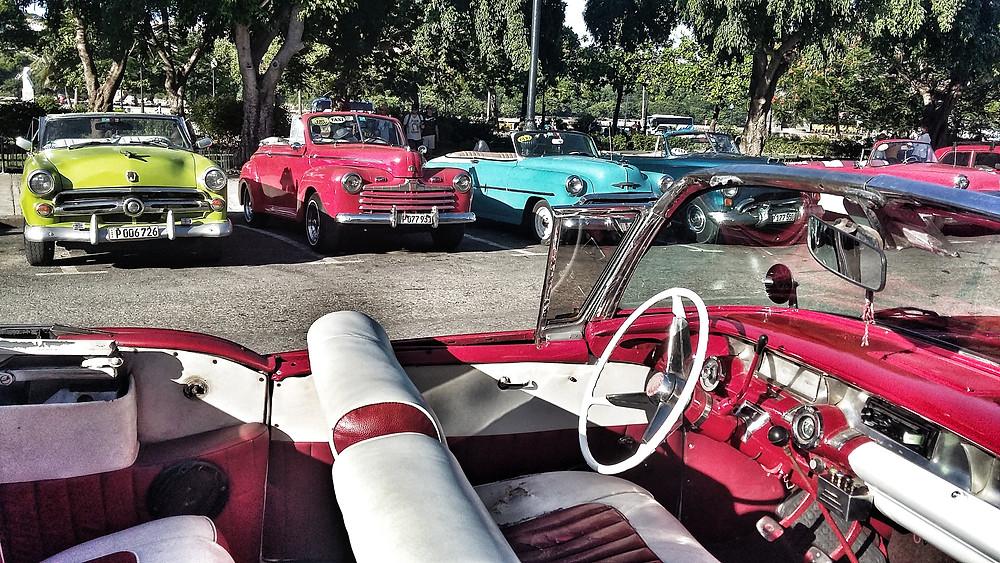 Classics on Cuba's maelcon, including Studebaker interior