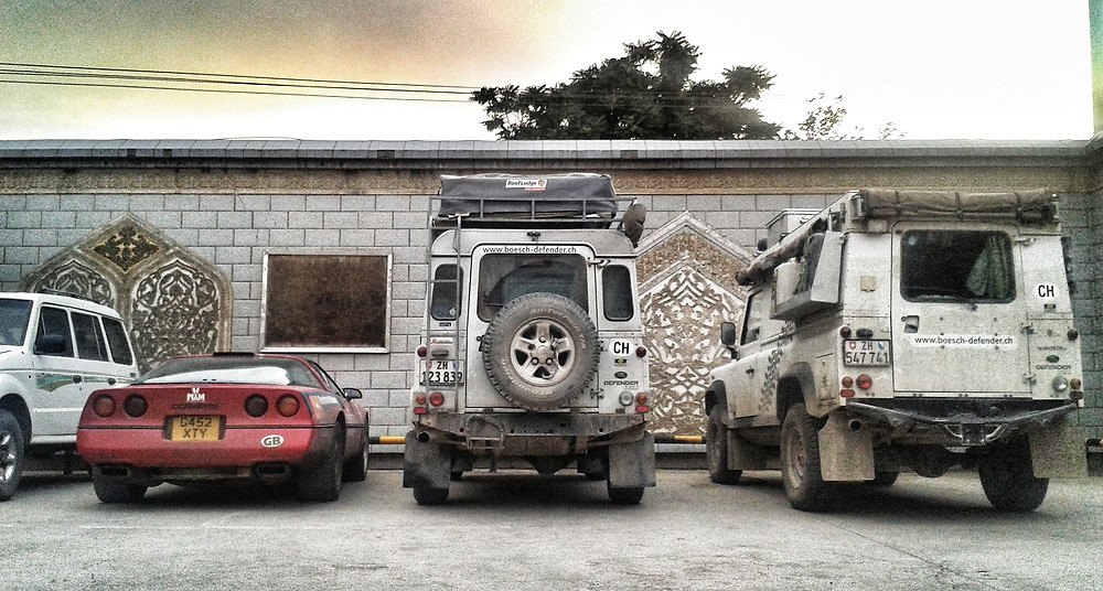 Chevrolet Corvette and Land Rover Defenders overlanding in Xinjiang, China.