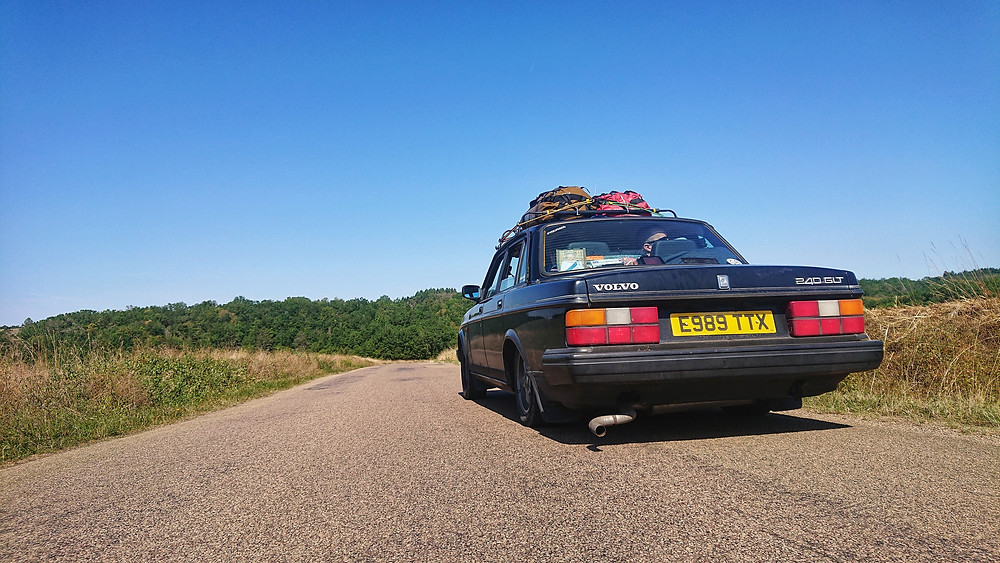 Volvo 240 in black, Euro road trip.