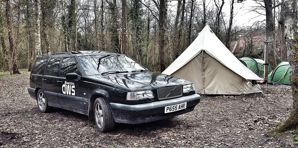 Black Volvo 850 T5 manual estate camping with bell tent