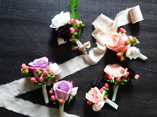 Kari + Rich   BOUTONNIERES + PHOTO Angelic Affairs   THEME Vibrancy in 2020  COLOR SCHEME White, peach, pink, emerald green, ivory, lavender, burgundy