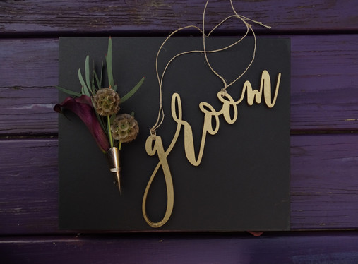 Chic, dark and moody, offbeat groom's boutonniere with dark burgundy Calla Lily, Scabiosa Pods, and Eucalyptus showcased in a silver lapel pin  PHOTO BY:  Angelic Affairs  |  Mario
