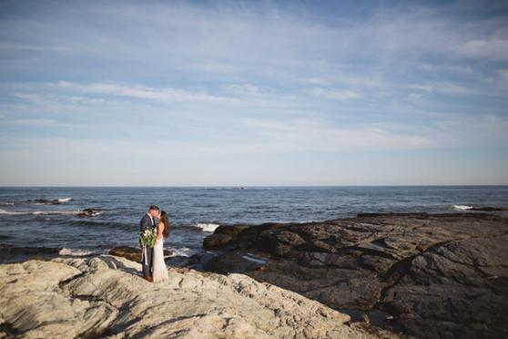 Kasey + Chris   FLORALS + FAVORS + STATIONERY: Angelic Affairs  PHOTO:   Selene Pozzer Photography  VENUE:   Newport Vineyards  COLOR SCHEME:   White and green  THEME:   Boho Vineyard