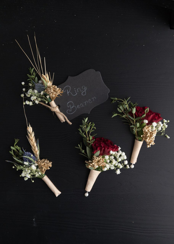 Rustic, fall-themed boutonnieres wrapped in twine  PHOTO BY:  Angelic Affairs  |  Mario