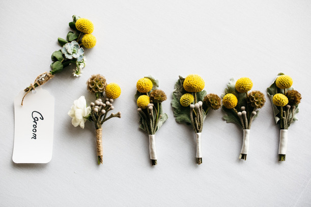 Offbeat New Orleans meets vintage New England nautical boutonnieres with the groom's boutonniere featuring a fleur de lis  PHOTO BY:  Frame & Anchor  PUBLISHED BY:  RI Engaged Magazine