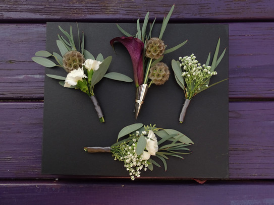 Chic, dark and moody, offbeat boutonnieres with the groom's boutonniere featured in a silver lapel pin  PHOTO BY:  Angelic Affairs  |  Mario
