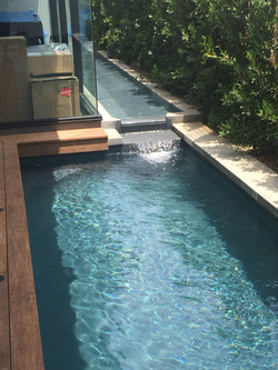 Water Feature Leading into Modern Design Pool