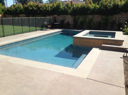 Tiled Spa and Pool with Large Pavers