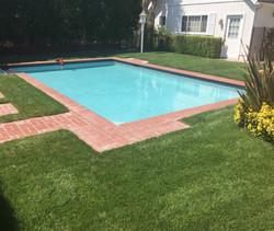 Pool with Brick Paving Surround
