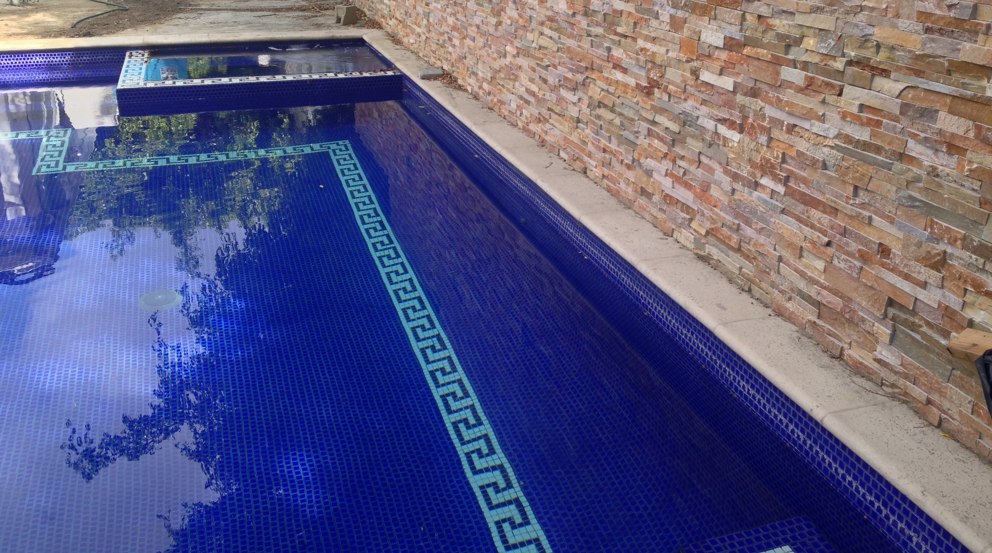 Grecian Pool with Cladded Wall Feature