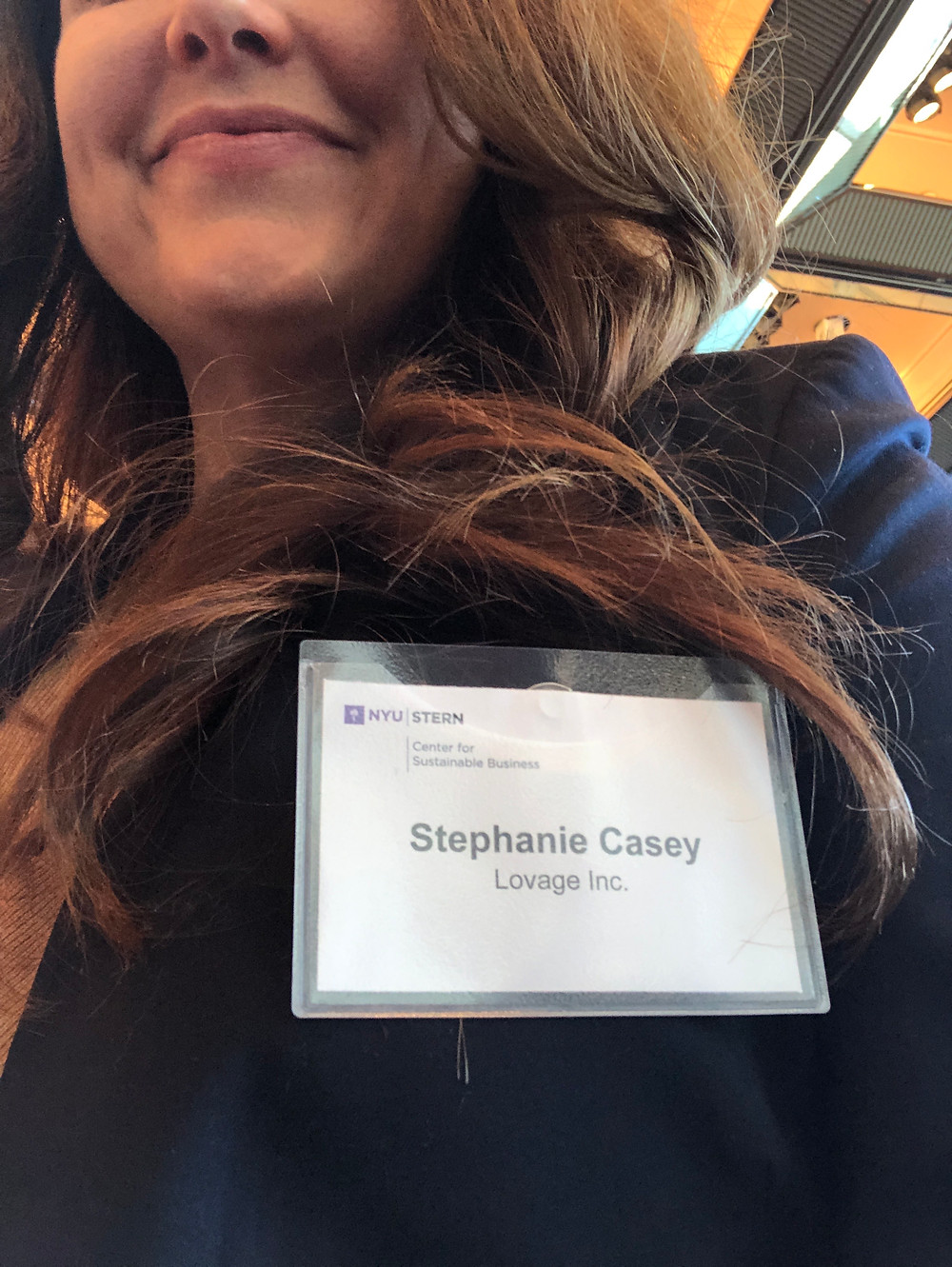 Lovage Inc. Founder, Stephanie M. Casey, wears her Stern Center For Sustainable Business Name Badge