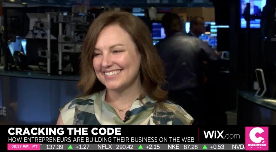 Stephanie M. Casey during live interview on the floor of the New York Stock Exchange with Cheddar News - NYSE ticker running at bottom of screen
