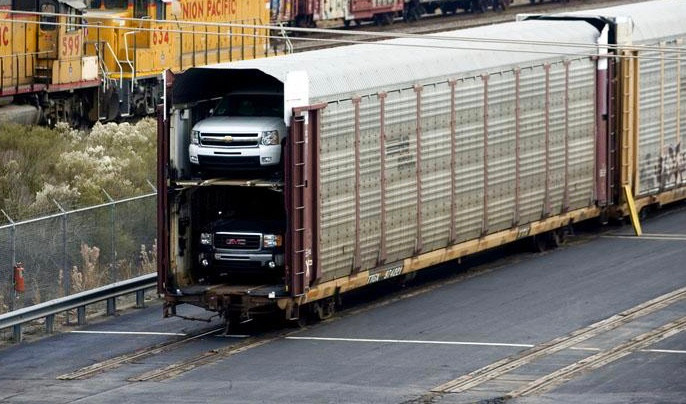 Stock photo of GM truck shipment by rail