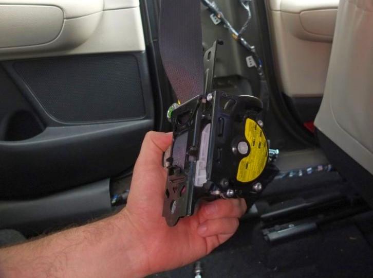 Stock Photo of seat belt retractor
