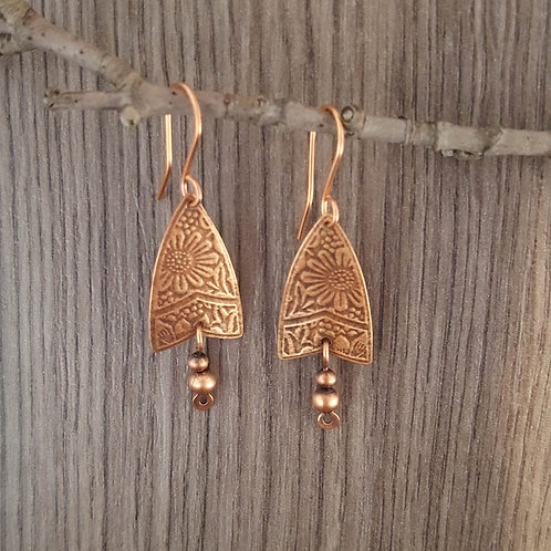 Triangular shaped patterned copper earrings with copper beads.