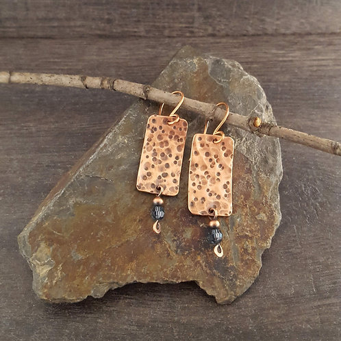 Rectangular hammered copper earrings with denim blue Swarovski crystal beads.