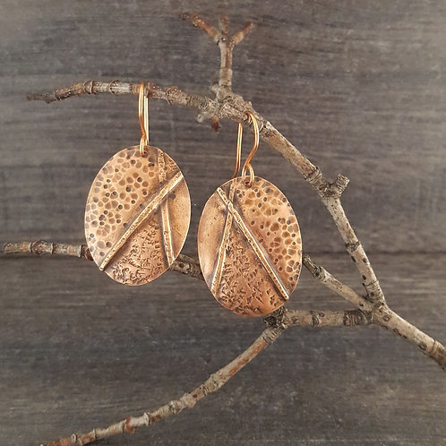 Slightly domed oval textured fold-formed copper earrings