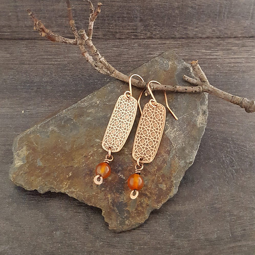 Textured rectangular copper earrings with carnelian beads.