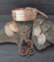 handcrafted copper bracelets, copper earrings and copper pendant
