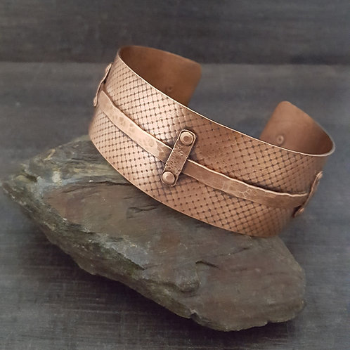 Wide textured copper cuff bracelet with a hammered copper belt that has been riveted on.
