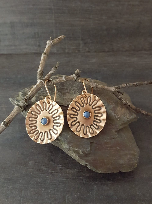 Oval shaped copper earrings with daisy design.  Denim Lapis stone mounted in the middle.