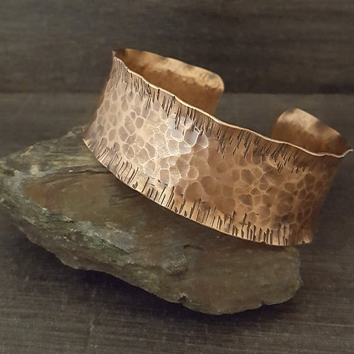 Hammered textured wide copper cuff bracelet with ruffled edge.