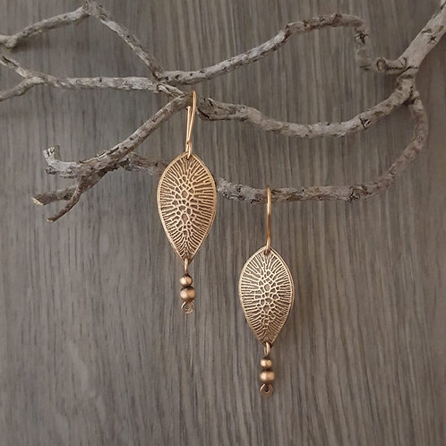 Inverted teardrop shaped pattern textured copper earrings with copper beads.