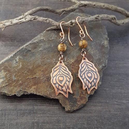 Peacock design copper earrings with brown jasper beads.